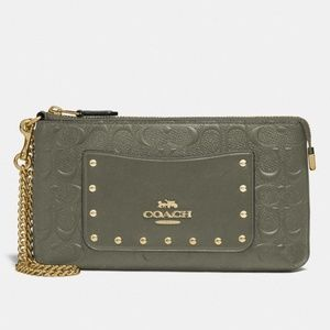 - NWT Authentic Coach large wristlet in signature leather